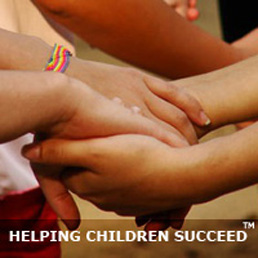 Photo showing holding hands: Helping Children Together.