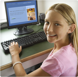 Photo showing a girl working with Dynaread on the computer.